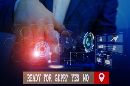 Handwriting text writing Ready For Gdpr Question Yes No. Conceptual photo Readiness General Data Protection Regulation Male human wear formal work suit presenting presentation using smart device