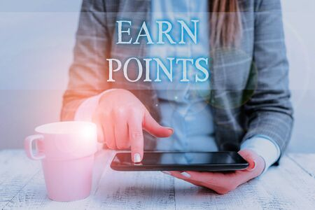 Handwriting text writing Earn Points. Conceptual photo getting praise or approval for something you have done Business woman sitting with mobile phone and cup of coffee on the table