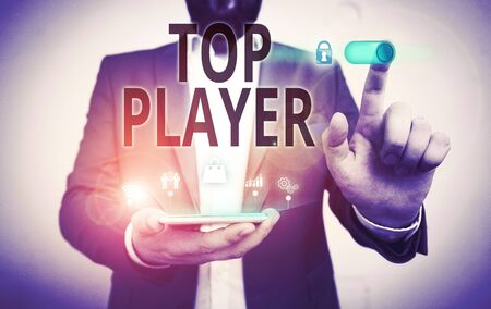 Word writing text Top Player. Business photo showcasing being best in sports game like football or electronic ones Male human wear formal work suit presenting presentation using smart device Banque d'images - 134800423