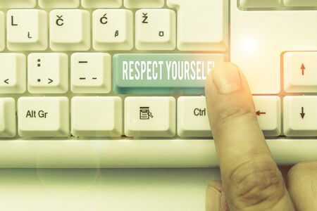 Writing note showing Respect Yourself. Business concept for believing that you good and worthy being treated well White pc keyboard with note paper above the white background