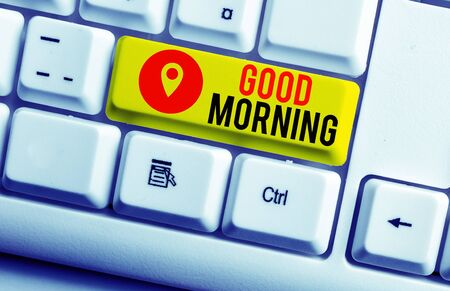 Text sign showing Good Morning. Business photo showcasing expressing good wishes on meeting or parting during the morning White pc keyboard with empty note paper above white background key copy space