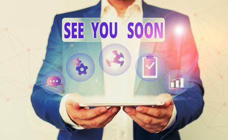 Word writing text See You Soon. Business photo showcasing used for saying goodbye to someone and going to meet again soon Male human wear formal work suit presenting presentation using smart device