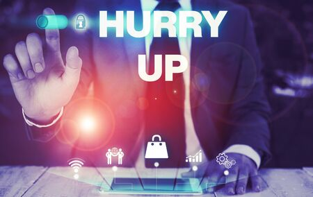 Conceptual hand writing showing Hurry Up. Concept meaning asking someone to do a job very fast Quickly Lets go Encourage Male wear formal suit presenting presentation smart device Stock Photo - 134800524