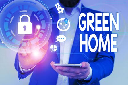 Word writing text Green Home. Business photo showcasing An area filled with plants and trees where you can relax Male human wear formal work suit presenting presentation using smart device