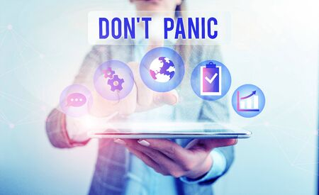 Conceptual hand writing showing Don T Panic. Concept meaning sudden strong feeling of fear prevents reasonable thought Female human wear formal work suit presenting smart device
