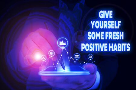 Handwriting text writing Give Yourself Some Fresh Positive Habits. Conceptual photo Get healthy positive routines Male human wear formal work suit presenting presentation using smart device Reklamní fotografie