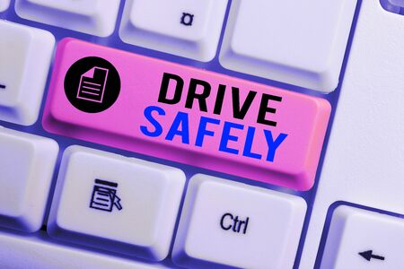 Word writing text Drive Safely. Business photo showcasing you should follow the rules of the road and abide laws White pc keyboard with empty note paper above white background key copy space Stock Photo