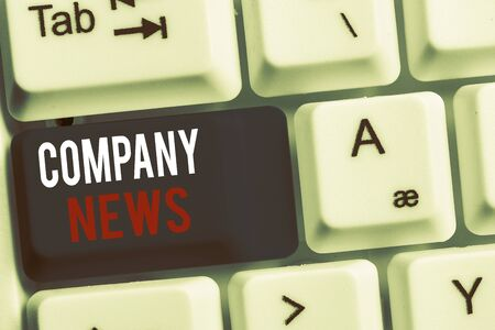 Handwriting text Company News. Conceptual photo provides news and feature articles about the company status White pc keyboard with empty note paper above white background key copy space