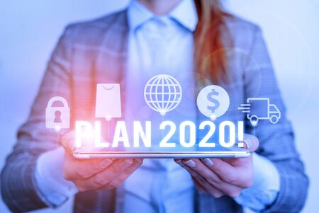 Handwriting text writing Plan 2020. Conceptual photo detailed proposal doing achieving something next year Modern technology tech loock Lady front presenting hands blue glow copy space