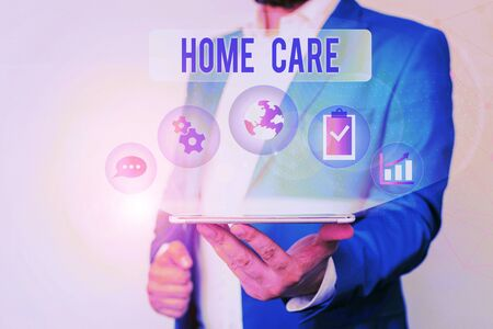 Text sign showing Home Care. Business photo text Place where showing can get the best service of comfort rendered Male human wear formal work suit presenting presentation using smart device