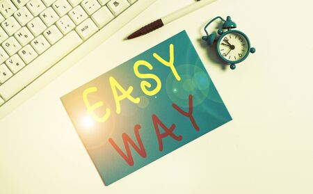 Writing note showing Easy Way. Business concept for making hard decision between two less and more effort method Flat lay above empty note paper on the pc keyboard pencils and clock Stock Photo