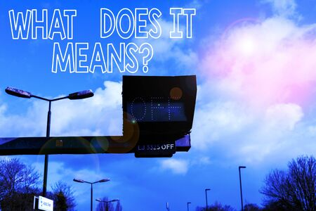 Conceptual hand writing showing What Does It Means question. Concept meaning asking someone about meaning something said and you do not understand Front view lamp post with two lamps sunny day sky background Banque d'images