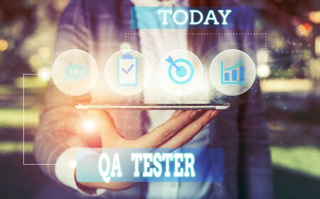 Text sign showing Qa Tester. Business photo showcasing Quality assurance of an on going project before implementation Female human wear formal work suit presenting presentation use smart device Banco de Imagens