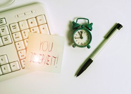 Text sign showing You Deserve It. Business photo text should have it because of their qualities or actions White pc keyboard with empty note paper above white background