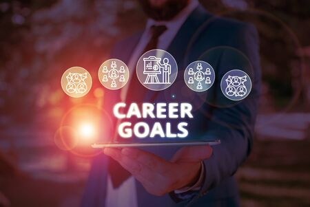 Word writing text Career Goals. Business photo showcasing profession that an individual intends to pursue in his career Male human wear formal work suit presenting presentation using smart device