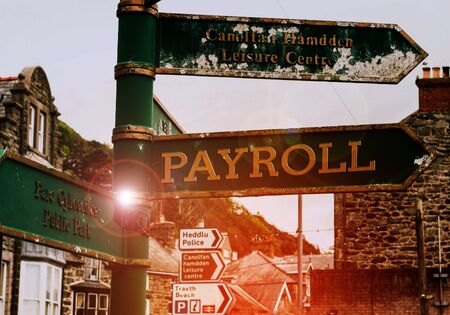 Handwriting text Payroll. Conceptual photo Amount of wages and salaries paid by a company to its employees Advertisement concept with empty copy space on the road sign