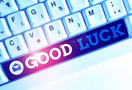 Conceptual hand writing showing Good Luck. Concept meaning A positive fortune or a happy outcome that a demonstrating can have White pc keyboard with note paper above the white background