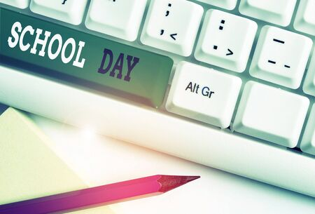 Conceptual hand writing showing School Day. Concept meaning starts from seven or eight am to three pm get taught there White pc keyboard with note paper above the white background