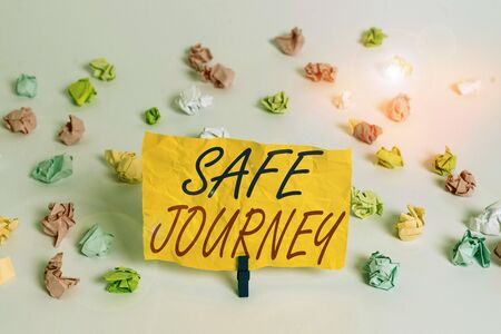 Word writing text Safe Journey. Business photo showcasing polite way of wishing someone a safe journey or Safe Travel Colored crumpled papers empty reminder white floor background clothespin
