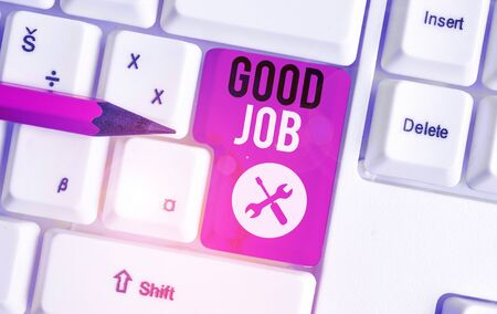 Text sign showing Good Job. Business photo showcasing encourage someone for his effort hard work winning or success White pc keyboard with empty note paper above white background key copy space