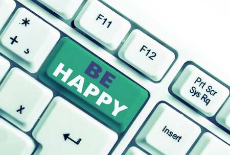 Word writing text Be Happy. Business photo showcasing live every moment as the last love your life work family White pc keyboard with empty note paper above white background key copy space 스톡 콘텐츠