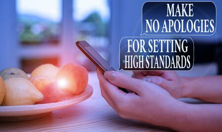 Text sign showing Make No Apologies For Setting High Standards. Business photo text Seeking quality productivity woman using smartphone office supplies technological devices inside home