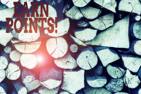 Text sign showing Earn Points. Business photo showcasing collecting scores in order qualify to win big prize Background dry chopped firewood logs stacked up in a pile winter chimney Stockfoto