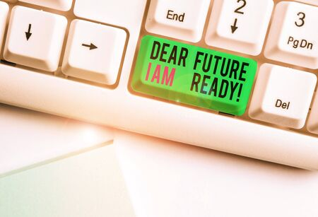Conceptual hand writing showing Dear Future I Am Ready. Concept meaning suitable state for action or situation being fully prepared White pc keyboard with note paper above the white background Reklamní fotografie