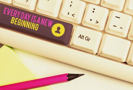 Text sign showing Every Day Is A New Beginning. Business photo text you have a chance to dream work live better White pc keyboard with empty note paper above white background key copy space Reklamní fotografie