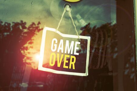 Text sign showing Game Over. Business photo text A situation in a particular sport that reach his finals or ending Empty black board with copy space for advertising. Blank dark board 版權商用圖片