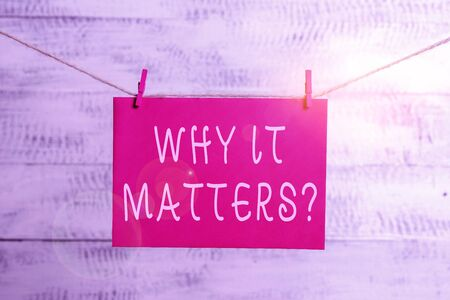 Word writing text Why It Matters Question. Business photo showcasing most important thing to be done when involved in situation Clothesline clothespin rectangle shaped paper reminder white wood desk Reklamní fotografie