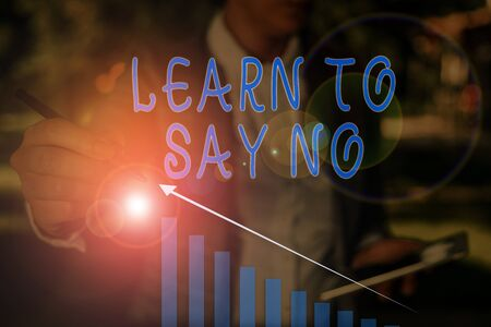 Word writing text Learn To Say No. Business photo showcasing decline or refuse few things before you destroy yourself Woman wear formal work suit presenting presentation using smart device Reklamní fotografie