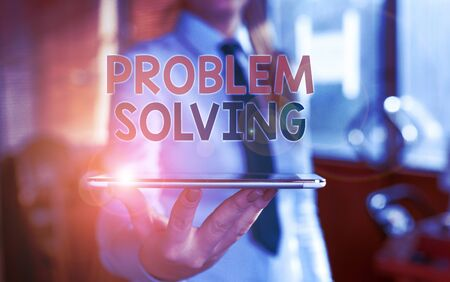 Writing note showing Problem Solving. Business concept for process of finding solutions to difficult or complex issues Blurred woman in the background pointing with finger in empty space Reklamní fotografie