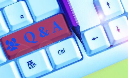 Writing note showing Q And A. Business concept for defined as questions being asked and answers White pc keyboard with note paper above the white background 写真素材