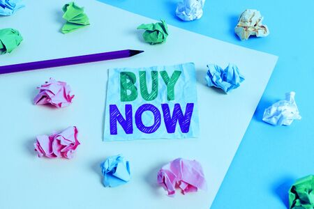 Handwriting text Buy Now. Conceptual photo asking someone to purchase your product Provide good Discount Colored crumpled papers empty reminder blue yellow background clothespin