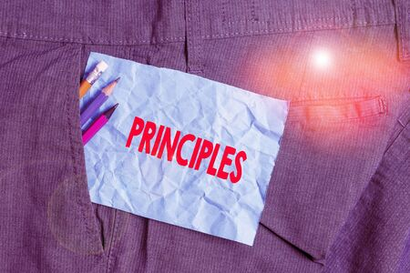 Text sign showing Principles. Business photo showcasing fundamental truth that serves as the base for a system of belief Writing equipment and blue note paper inside pocket of man work trousers Stock fotó