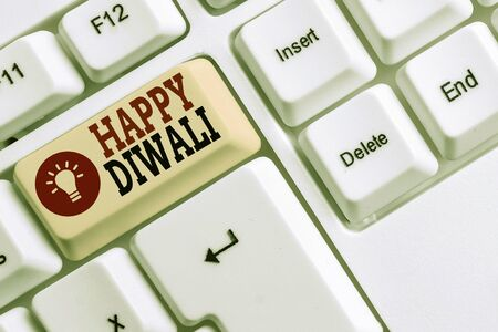 Word writing text Happy Diwali. Business photo showcasing festival of lights that celebrated by millions of Hindus White pc keyboard with empty note paper above white background key copy space