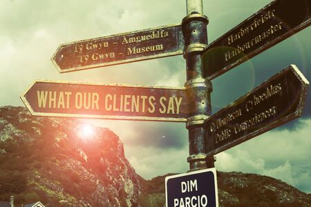 Word writing text What Our Clients Say. Business photo showcasing testimonials or feedback of aclient about the product Road sign on the crossroads with blue cloudy sky in the background