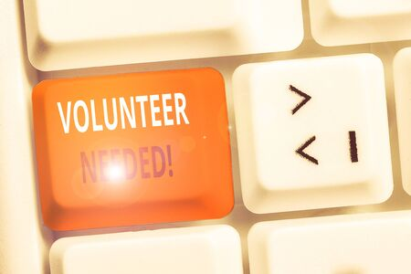 Handwriting text writing Volunteer Needed. Conceptual photo asking demonstrating to work for organization without being paid White pc keyboard with empty note paper above white background key copy space
