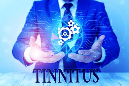 Writing note showing Tinnitus. Business concept for A ringing or music and similar sensation of sound in ears Male human wear formal suit presenting using smart device