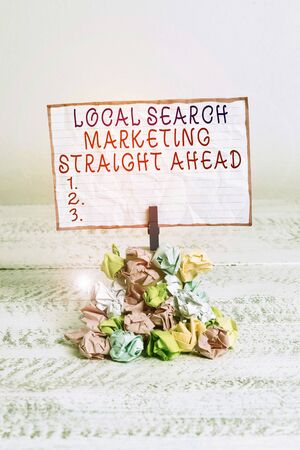 Conceptual hand writing showing Local Search Marketing Straight Ahead. Concept meaning answering to someone about destination Reminder pile colored crumpled paper clothespin wooden space