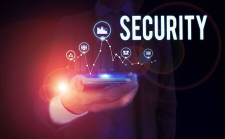 Word writing text Security. Business photo showcasing The state of feeling safe stable and free from fear or danger Woman wear formal work suit presenting presentation using smart device Stock Photo