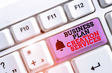 Writing note showing Business Plan Creation Services. Business concept for paying for professional to create strategy White pc keyboard with note paper above the white background