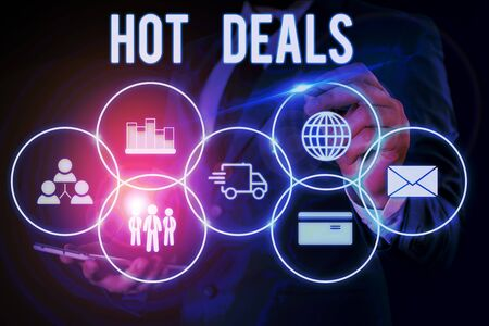 Word writing text Hot Deals. Business photo showcasing An agreement through which one of the paties is offered and accept Male human wear formal work suit presenting presentation using smart device Stok Fotoğraf