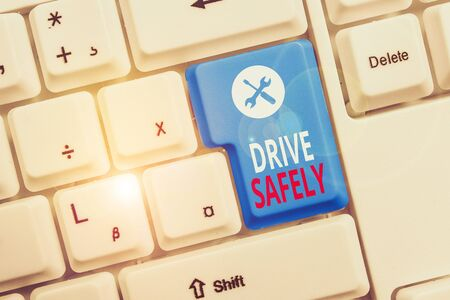Conceptual hand writing showing Drive Safely. Concept meaning you should follow the rules of the road and abide laws Keyboard with note paper on white background key copy space Stock Photo