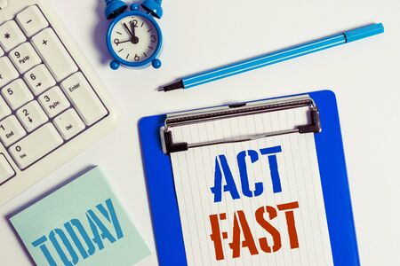 Writing note showing Act Fast. Business concept for Voluntarily move in the highest state of speed initiatively Flat lay above table with clock pc keyboard and copy space note paper Stock fotó