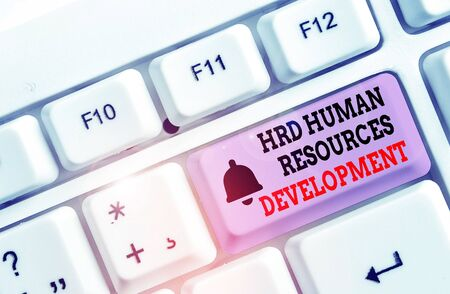 Writing note showing Hrd Huanalysis Resources Development. Business concept for helping employees develop demonstratingal skills White pc keyboard with note paper above the white background