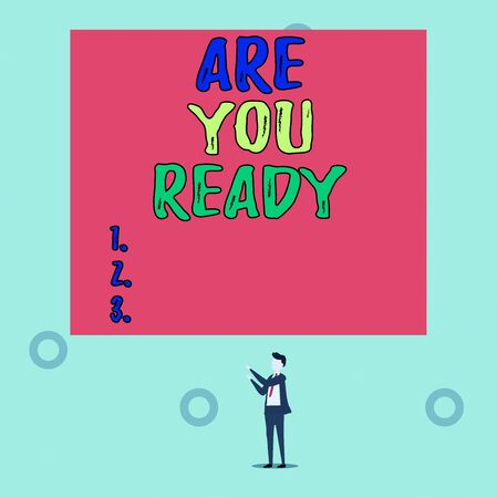 Word writing text Are You Ready. Business photo showcasing Alertness Preparedness Urgency Game Start Hurry Wide awake Isolated view young man standing pointing upwards two hands big rectangle