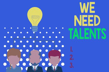Writing note showing We Need Talents. Business concept for new recruitment Making interviews Choose creative showing Group three executive persons sharing idea icon. Startup team meeting