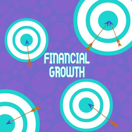 Conceptual hand writing showing Financial Growth. Concept meaning increase in finances of an organization or individual Arrow and round target asymmetrical shape multicolour design Фото со стока